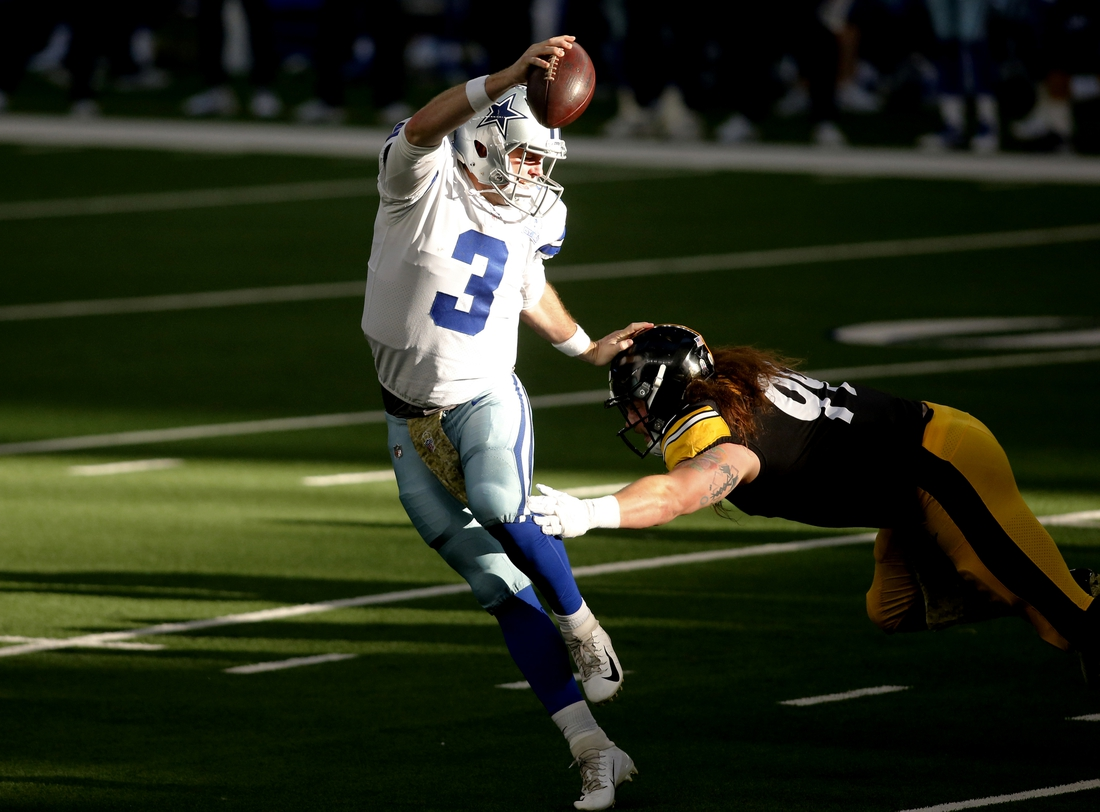 Nov 8, 2020; Arlington, Texas, USA; Dallas Cowboys quarterback Garrett Gilbert (3) evades Pittsburgh Steelers defensive tackle Henry Mondeaux (99) in the second quarter at AT&T Stadium. Mandatory Credit: Tim Heitman-USA TODAY Sports
