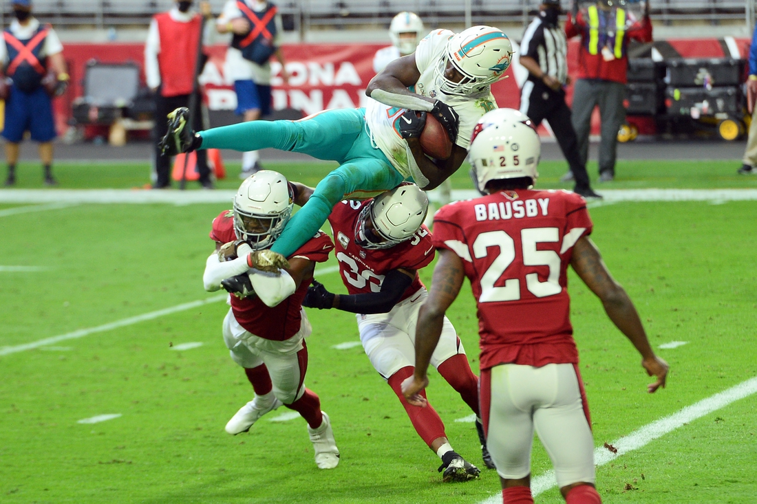 Nov 8, 2020; Glendale, Arizona, USA; Miami Dolphins wide receiver Preston Williams (18) dives for a touchdown against the Arizona Cardinals during the first half at State Farm Stadium. Mandatory Credit: Joe Camporeale-USA TODAY Sports