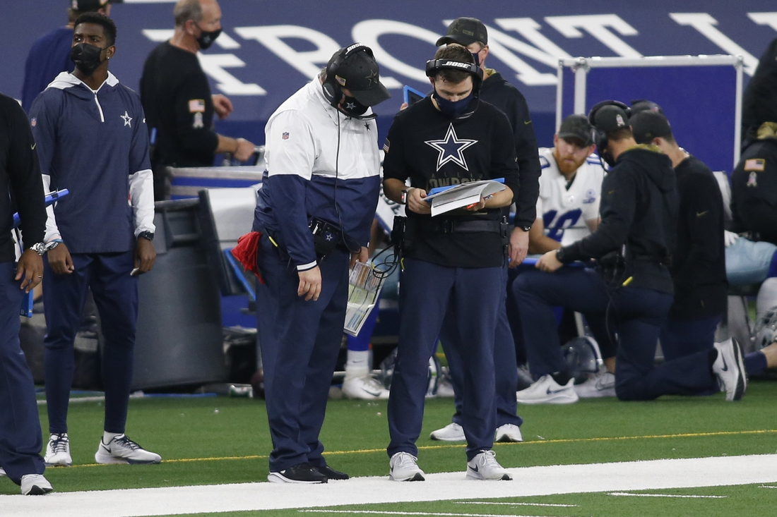 Nov 8, 2020; Arlington, Texas, USA; Dallas Cowboys head coach Mike McCarthy and offensive coordinator Kellen Moore look at the playbook in the fourth quarter against the Pittsburgh Steelers at AT&T Stadium. Mandatory Credit: Tim Heitman-USA TODAY Sports