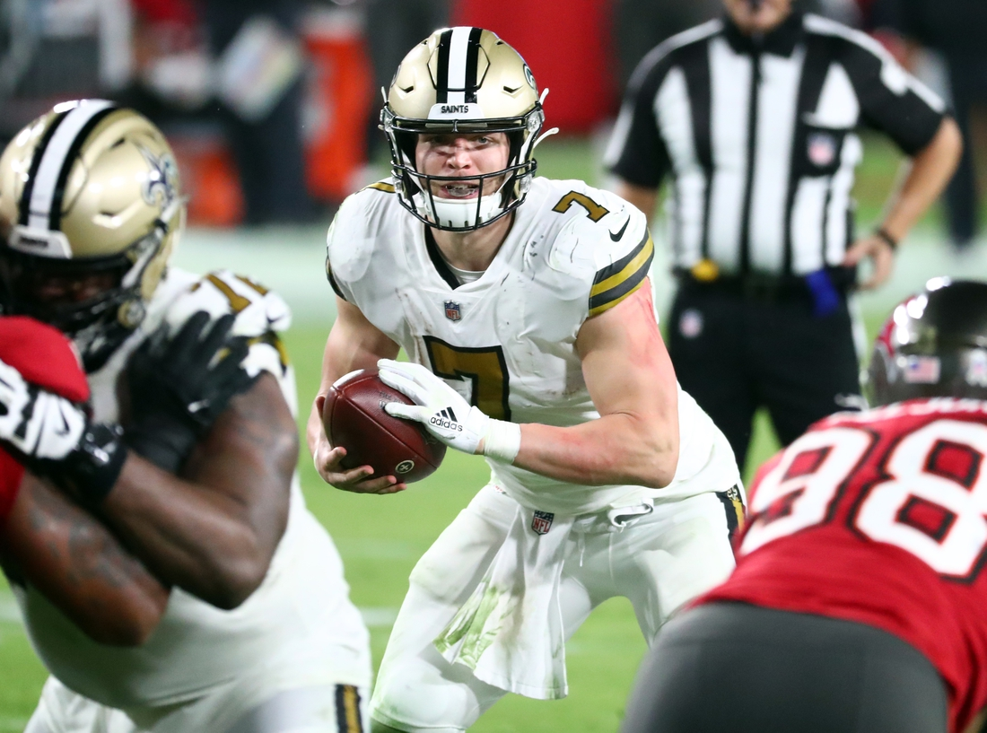 Nov 8, 2020; Tampa, Florida, USA; New Orleans Saints quarterback Taysom Hill (7) runs with the ball against the Tampa Bay Buccaneers during the second half at Raymond James Stadium. Mandatory Credit: Kim Klement-USA TODAY Sports