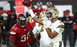 Nov 8, 2020; Tampa, Florida, USA;New Orleans Saints quarterback Jameis Winston (2) throws the ball as Tampa Bay Buccaneers defensive end William Gholston (92) rushes  during the second half at Raymond James Stadium. Mandatory Credit: Kim Klement-USA TODAY Sports