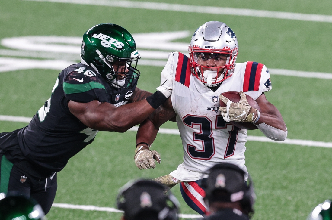 Nov 9, 2020; East Rutherford, New Jersey, USA; New England Patriots running back Damien Harris (37) carries the ball as New York Jets linebacker Neville Hewitt (46) tackles during the first half at MetLife Stadium. Mandatory Credit: Vincent Carchietta-USA TODAY Sports
