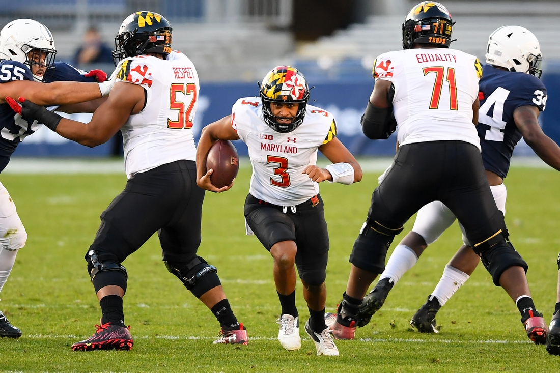Nov 7, 2020; University Park, Pennsylvania, USA; Maryland Terrapins quarterback Taulia Tagovailoa (3) runs with the ball against the Penn State Nittany Lions during the second quarter at Beaver Stadium. Mandatory Credit: Rich Barnes-USA TODAY Sports