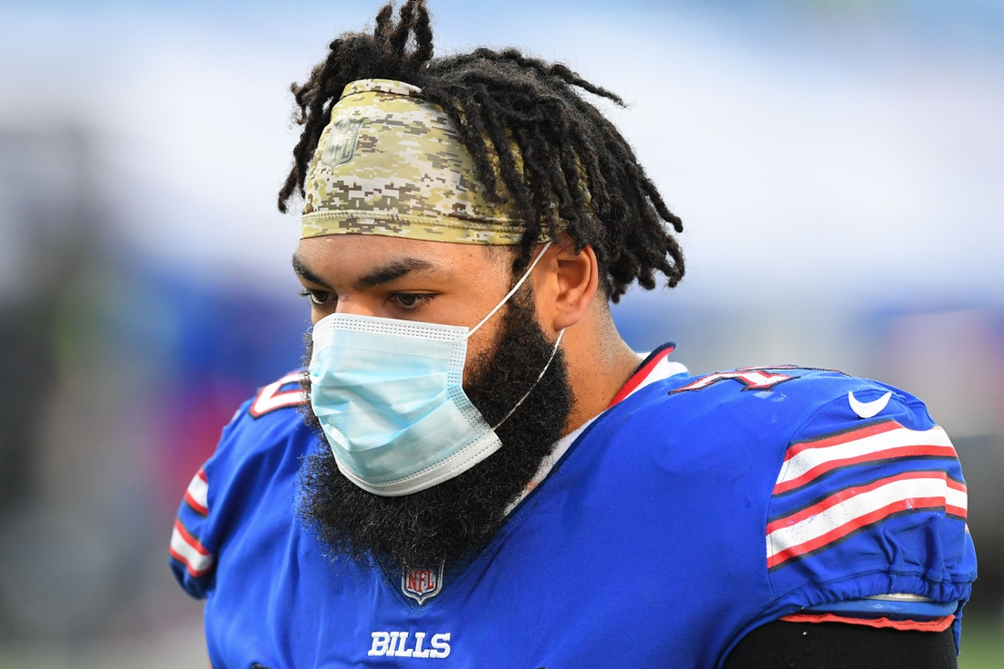Nov 8, 2020; Orchard Park, New York, USA; Buffalo Bills offensive guard Cody Ford (70) walks off the field wearing a mask following the game against the Seattle Seahawks at Bills Stadium. Mandatory Credit: Rich Barnes-USA TODAY Sports