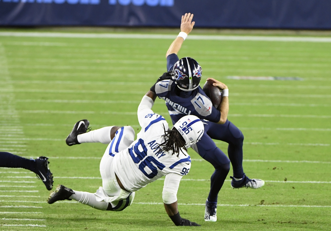 Nov 12, 2020; Nashville, Tennessee, USA;  Indianapolis Colts defensive tackle Denico Autry (96) brings down Tennessee Titans quarterback Ryan Tannehill (17) during the first half at Nissan Stadium. Mandatory Credit: Steve Roberts-USA TODAY Sports