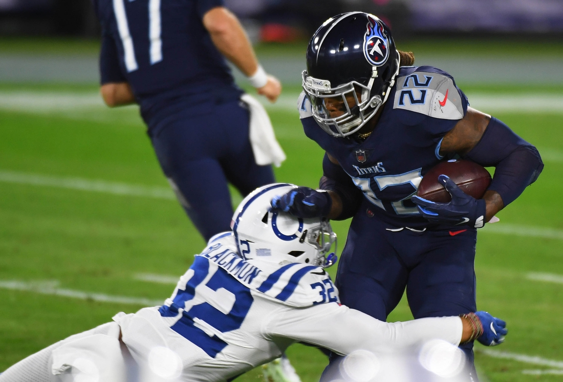 Nov 12, 2020; Nashville, Tennessee, USA; Tennessee Titans running back Derrick Henry (22) is stopped for a loss by Indianapolis Colts free safety Julian Blackmon (32) during the first half at Nissan Stadium. Mandatory Credit: Christopher Hanewinckel-USA TODAY Sports