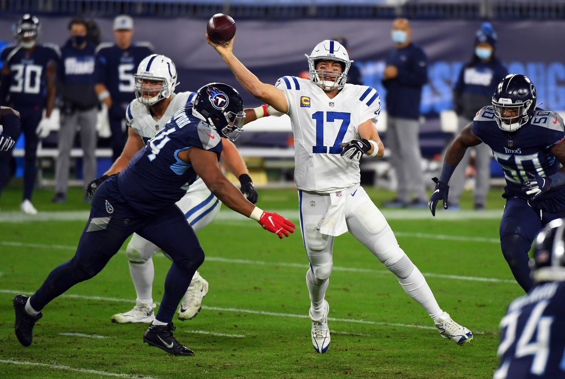 Nov 12, 2020; Nashville, Tennessee, USA; Indianapolis Colts quarterback Philip Rivers (17) throws against Tennessee Titans defensive end Jack Crawford (94) during the first half at Nissan Stadium. Mandatory Credit: Christopher Hanewinckel-USA TODAY Sports