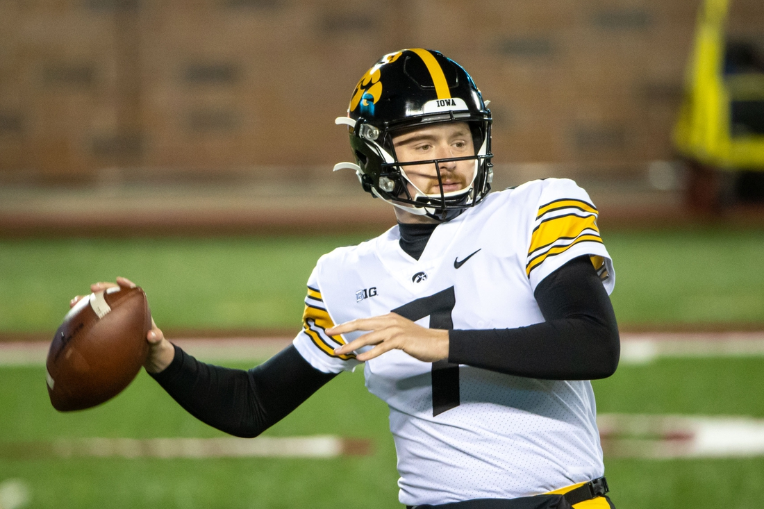 Nov 13, 2020; Minneapolis, Minnesota, USA; Iowa Hawkeyes quarterback Spencer Petras (7) drops back for a pass during pre game warmups before a game against the Minnesota Golden Gophers at TCF Bank Stadium. Mandatory Credit: Jesse Johnson-USA TODAY Sports