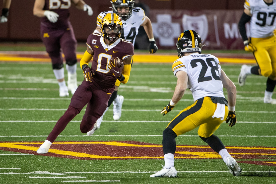 Nov 13, 2020; Minneapolis, Minnesota, USA; Minnesota Golden Gophers wide receiver Rashod Bateman (0) rushes with the ball after making a catch in the second half against the Iowa Hawkeyes at TCF Bank Stadium. Mandatory Credit: Jesse Johnson-USA TODAY Sports