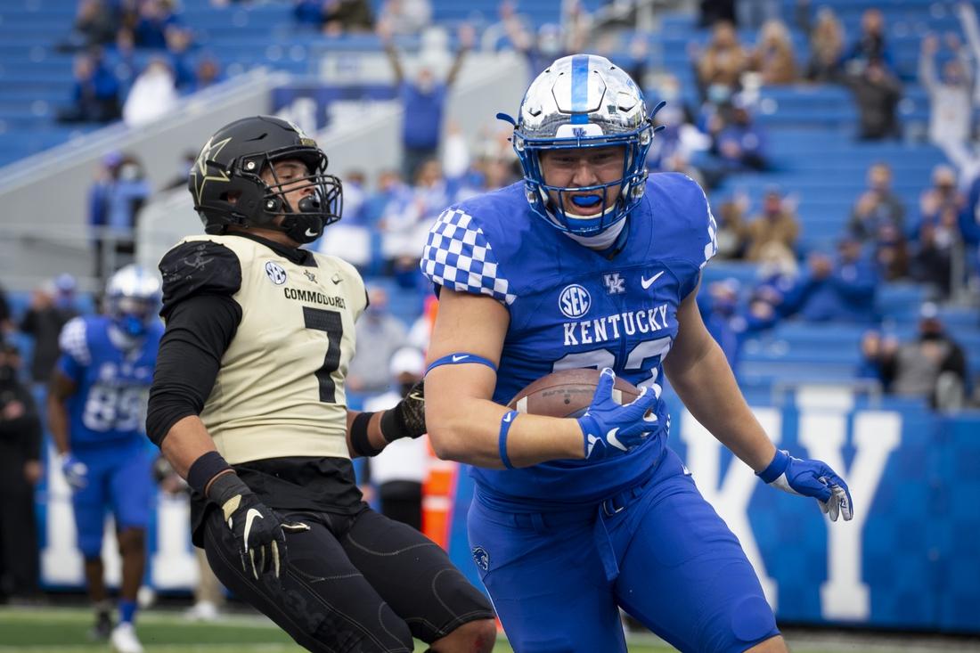 Nov 14, 2020; Lexington, Kentucky, USA; Kentucky Wildcats defensive back Tyrell Ajian (23) scores a touchdown against Vanderbilt Commodores wide receiver Cam Johnson (7) at Kroger Field. Mandatory Credit: Arden Barnes-USA TODAY Sports