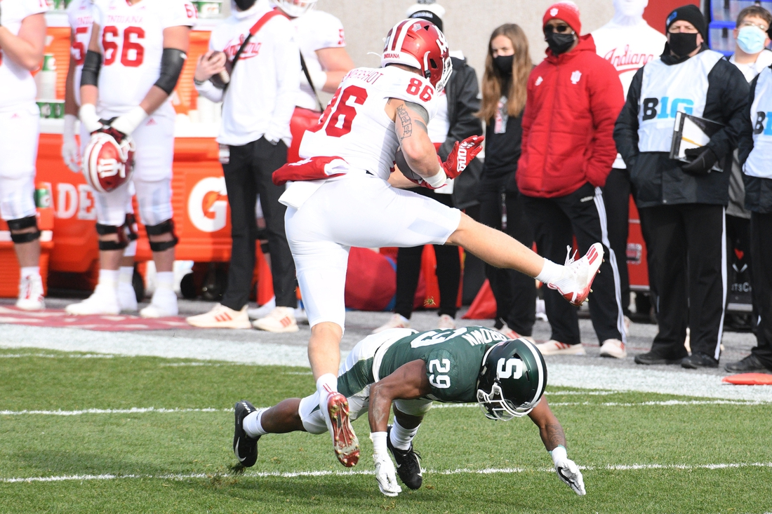 Nov 14, 2020; East Lansing, Michigan, USA; Indiana Hoosiers tight end Peyton Hendershot (86) leaps over Michigan State Spartans cornerback Shakur Brown (29) during the second quarter at Spartan Stadium. Mandatory Credit: Tim Fuller-USA TODAY Sports