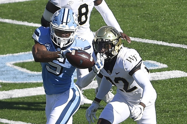 Nov 14, 2020; Chapel Hill, North Carolina, USA; North Carolina Tar Heels wide receiver Dazz Newsome (5) catches the ball as Wake Forest Demon Deacons defensive back A.J. Williams (22) defends in the first quarter at Kenan Memorial Stadium. Mandatory Credit: Bob Donnan-USA TODAY Sports