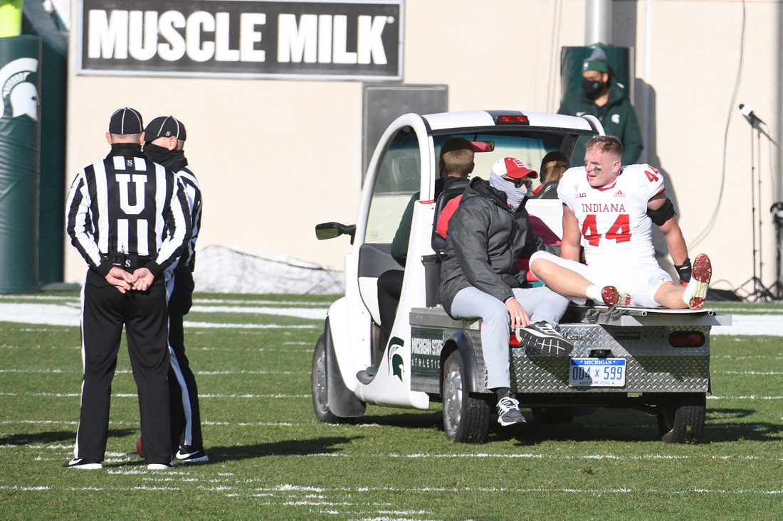 Nov 14, 2020; East Lansing, Michigan, USA; Indiana Hoosiers linebacker Thomas Allen (44) is taken off the field after an injury during the third quarter against the Michigan State Spartans at Spartan Stadium. Mandatory Credit: Tim Fuller-USA TODAY Sports