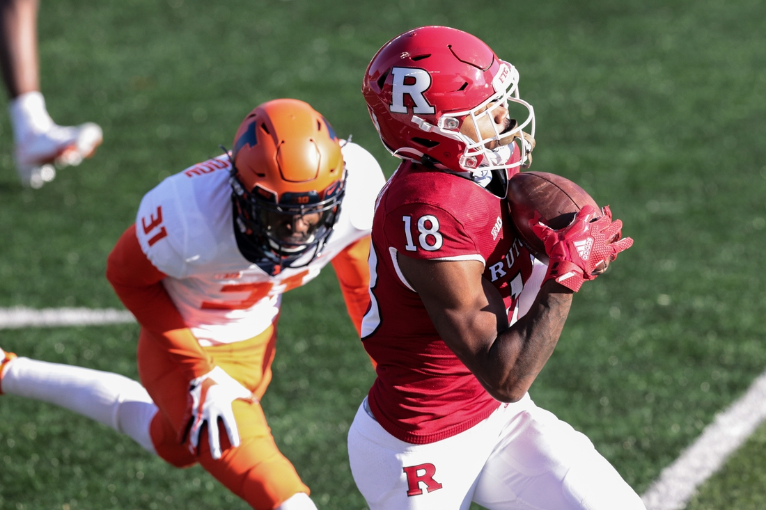 Nov 14, 2020; Piscataway, New Jersey, USA; Rutgers Scarlet Knights wide receiver Bo Melton (18) catches the ball in font of Illinois Fighting Illini defensive back Devon Witherspoon (31) during the first half at SHI Stadium. Mandatory Credit: Vincent Carchietta-USA TODAY Sports
