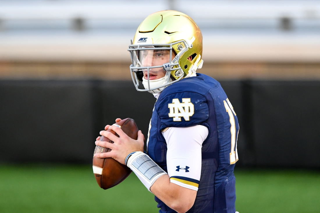 Nov 14, 2020; Chestnut Hill, Massachusetts, USA; Notre Dame Fighting Irish quarterback Ian Book (12) throws the ball during warms ups before a game against the Boston College Eagles at Alumni Stadium. Mandatory Credit: Brian Fluharty-USA TODAY Sports