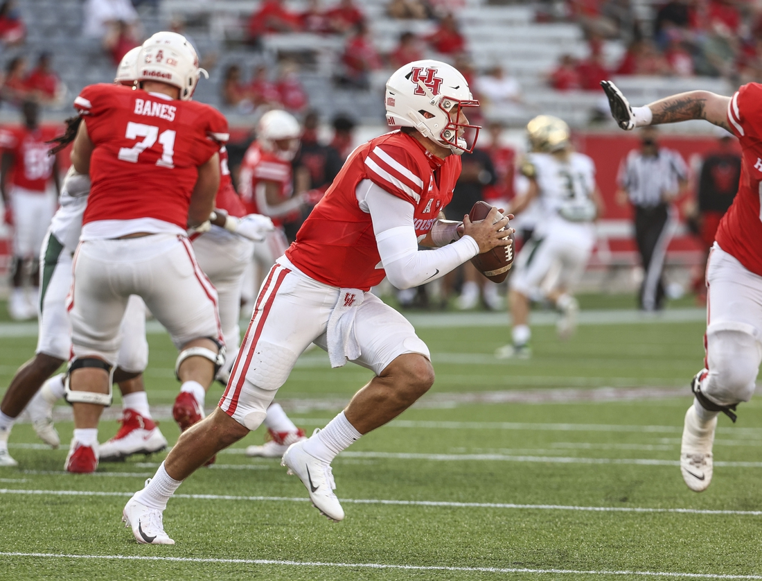 Nov 14, 2020; Houston, Texas, USA; Houston Cougars quarterback Clayton Tune (3) runs with the ball during the second quarter against the South Florida Bulls at TDECU Stadium. Mandatory Credit: Troy Taormina-USA TODAY Sports