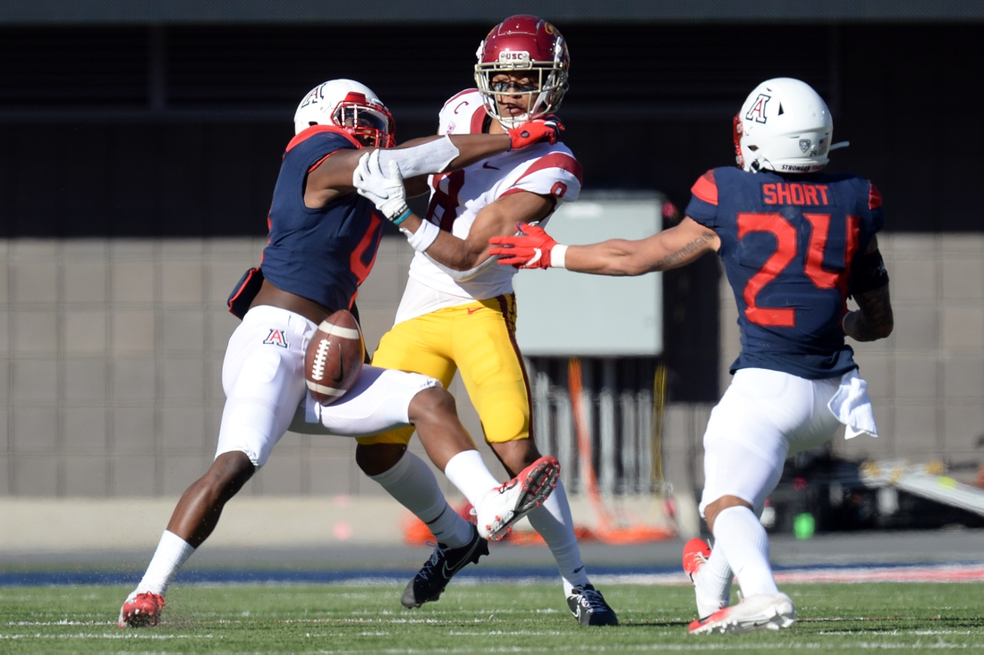 Nov 14, 2020; Tucson, Arizona, USA; USC Trojans wide receiver Amon-Ra St. Brown (8) is unable to make a catch against Arizona Wildcats defensive back Christian Roland-Wallace (4) during the first half at Arizona Stadium. Mandatory Credit: Joe Camporeale-USA TODAY Sports
