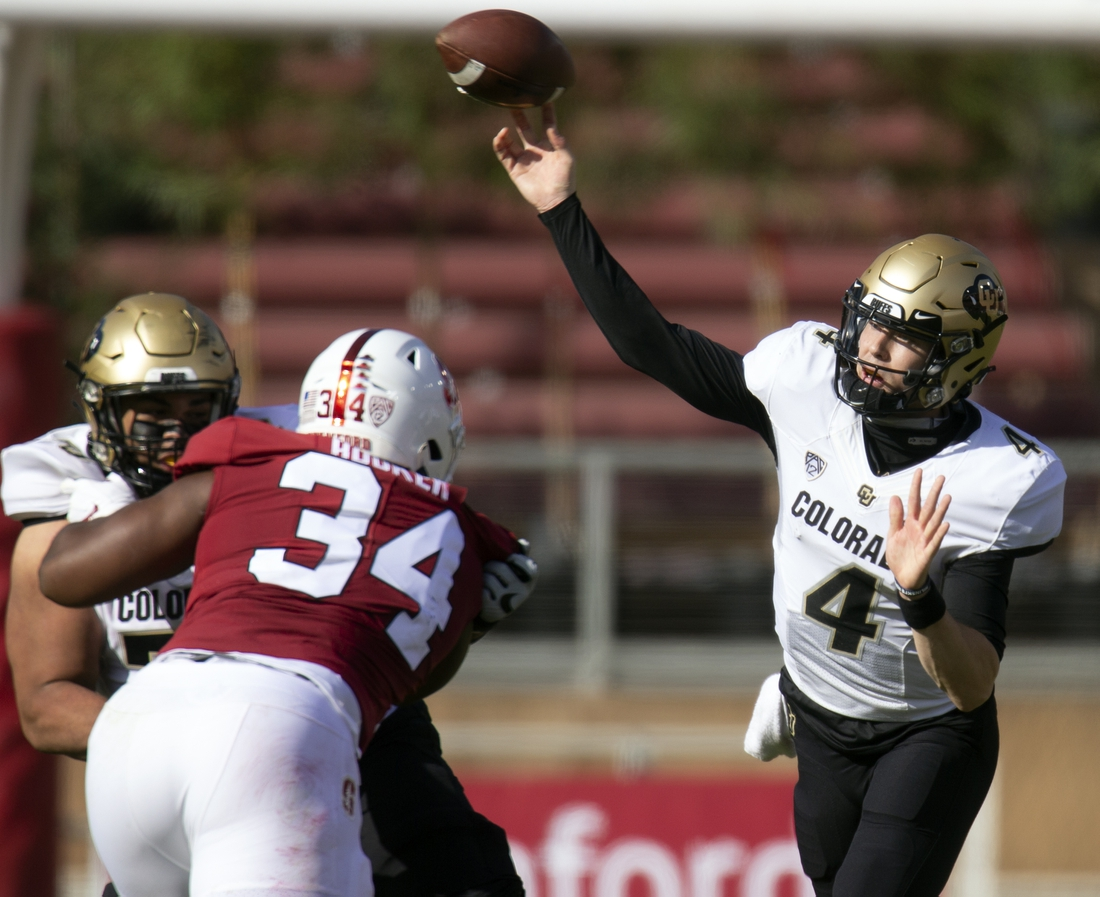 Nov 14, 2020; Stanford, California, USA; Colorado Buffaloes quarterback Sam Noyer (4) throws a pass over Stanford Cardinal defensive end Thomas Booker (34) during the first quarter of an NCAA college football game at Stanford Stadium. Mandatory Credit: D. Ross Cameron-USA TODAY Sports