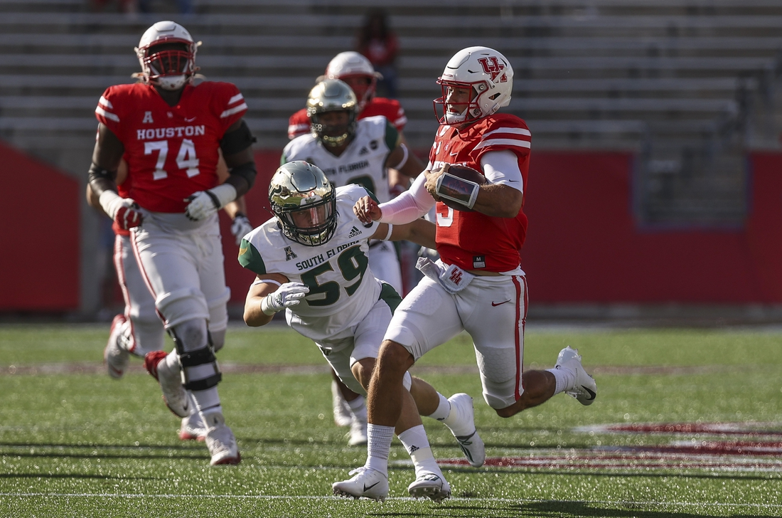 Nov 14, 2020; Houston, Texas, USA; Houston Cougars quarterback Clayton Tune (3) runs with the ball during the first quarter against the South Florida Bulls at TDECU Stadium. Mandatory Credit: Troy Taormina-USA TODAY Sports