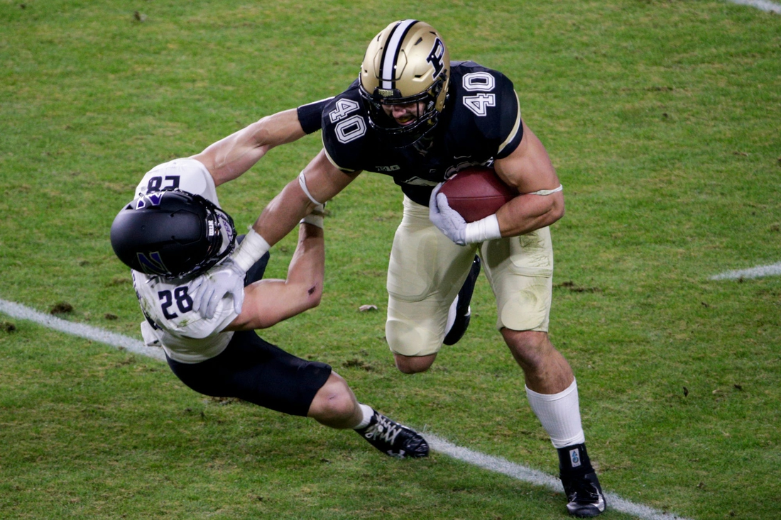 Nov 14, 2020; West Lafayette, IN, USA;  Northwestern linebacker Chris Bergin (28) attempts to tackle Purdue running back Zander Horvath (40) during the first quarter of a NCAA football game at Ross-Ade Stadium in West Lafayette.  Mandatory Credit: Nikos Frazier-USA TODAY NETWORK
