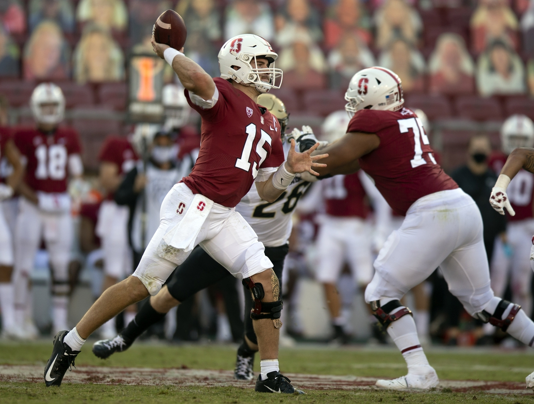 Nov 14, 2020; Stanford, California, USA; Stanford Cardinal quarterback Davis Mills (15) passes against the Colorado Buffaloes during the fourth quarter of an NCAA college football game at Stanford Stadium. Mandatory Credit: D. Ross Cameron-USA TODAY Sports
