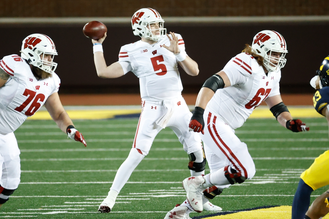 Nov 14, 2020; Ann Arbor, Michigan, USA;  Wisconsin Badgers quarterback Graham Mertz (5) passes against the Michigan Wolverines in the first half at Michigan Stadium. Mandatory Credit: Rick Osentoski-USA TODAY Sports
