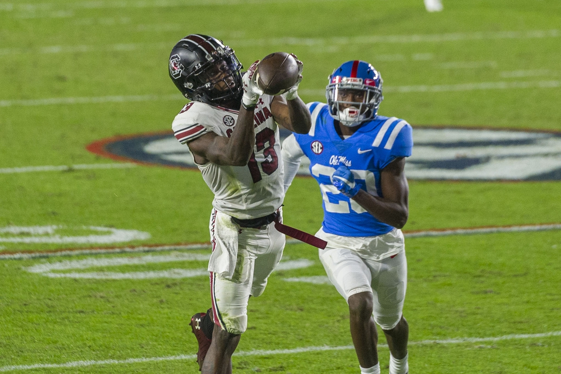 Nov 14, 2020; Oxford, Mississippi, USA; South Carolina Gamecocks wide receiver Shi Smith (13) catches a pass against Mississippi Rebels defensive back Keidron Smith (20) during the first half at Vaught-Hemingway Stadium. Mandatory Credit: Justin Ford-USA TODAY Sports