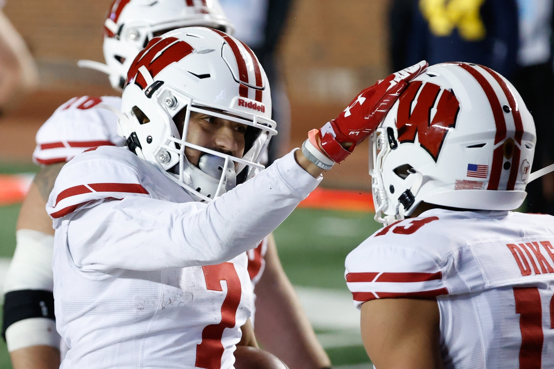 Nov 14, 2020; Ann Arbor, Michigan, USA; Wisconsin Badgers wide receiver Danny Davis III (7) celebrates his touchdown with Wisconsin Badgers wide receiver Chimere Dike (13) in the second half against the Michigan Wolverines at Michigan Stadium. Mandatory Credit: Rick Osentoski-USA TODAY Sports