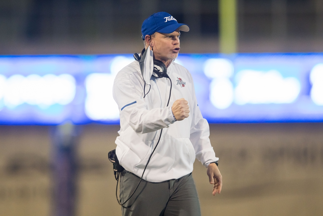 Nov 14, 2020; Tulsa, Oklahoma, USA; Tulsa Golden Hurricane head coach Philip Montgomery pumps his fist during the fourth quarter of the game against Southern Methodist Mustangs at Skelly Field at H.A. Chapman Stadium. TU won the game 28-24. Mandatory Credit: Brett Rojo-USA TODAY Sports