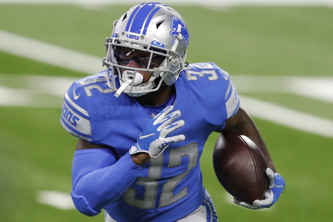 Nov 15, 2020; Detroit, Michigan, USA; Detroit Lions running back D'Andre Swift (32) runs the ball during the first quarter against the Washington Football Team at Ford Field. Mandatory Credit: Raj Mehta-USA TODAY Sports
