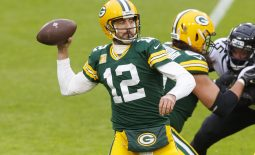 Nov 15, 2020; Green Bay, Wisconsin, USA;  Green Bay Packers quarterback Aaron Rodgers (12) throws a pass against the Jacksonville Jaguars during the second quarter at Lambeau Field. Mandatory Credit: Jeff Hanisch-USA TODAY Sports