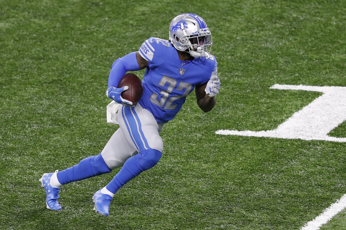 Nov 15, 2020; Detroit, Michigan, USA; Detroit Lions running back D'Andre Swift (32) runs after a catch for a touchdown during the third quarter against the Washington Football Team at Ford Field. Mandatory Credit: Raj Mehta-USA TODAY Sports