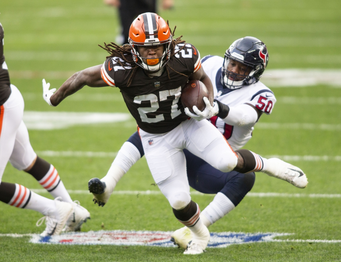 Nov 15, 2020; Cleveland, Ohio, USA; Cleveland Browns running back Kareem Hunt (27) breaks a tackle from Houston Texans linebacker Tyrell Adams (50) during the first quarter at FirstEnergy Stadium. Mandatory Credit: Scott Galvin-USA TODAY Sports