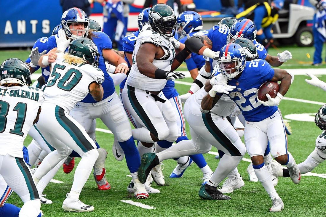 Nov 15, 2020; East Rutherford, New Jersey, USA; New York Giants running back Wayne Gallman (22) runs the ball against the Philadelphia Eagles during the second half at MetLife Stadium. Mandatory Credit: Robert Deutsch-USA TODAY Sports