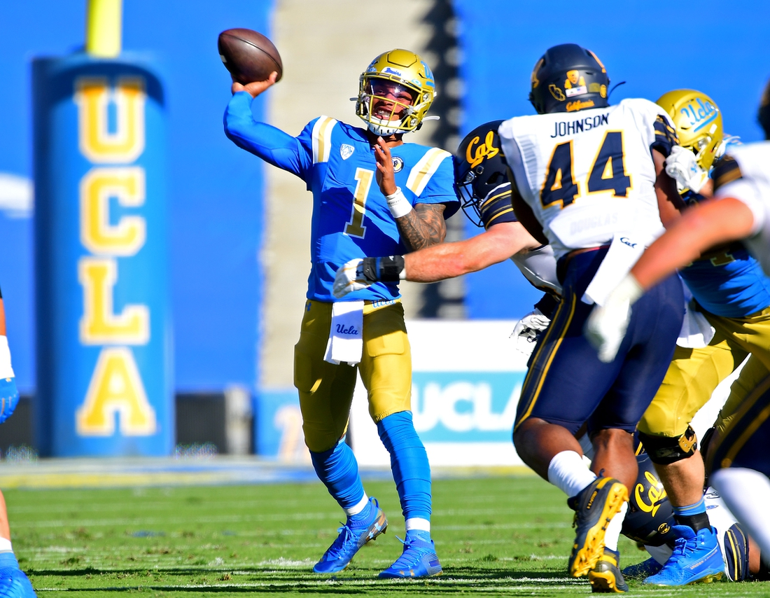 Nov 15, 2020; Pasadena, California, USA; UCLA Bruins quarterback Dorian Thompson-Robinson (1) throws a pass against the California Golden Bears in the first half at the Rose Bowl. Mandatory Credit: Jayne Kamin-Oncea-USA TODAY Sports