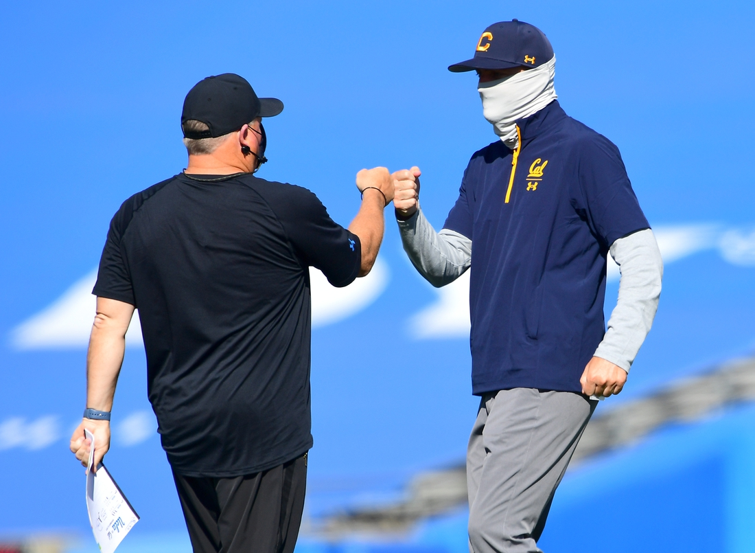 Nov 15, 2020; Pasadena, California, USA;   UCLA Bruins head coach Chip Kelly is greeted by California Golden Bears head coach Justin Wilcox after a game at the Rose Bowl. Mandatory Credit: Jayne Kamin-Oncea-USA TODAY Sports
