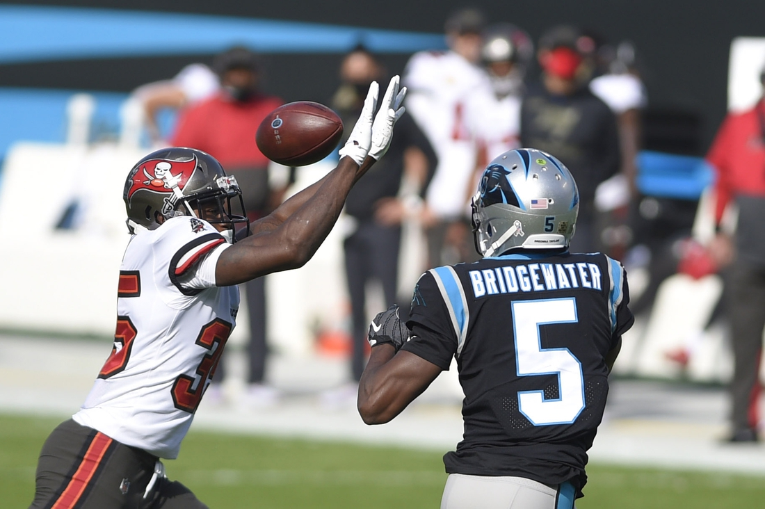 Nov 15, 2020; Charlotte, North Carolina, USA; Carolina Panthers quarterback Teddy Bridgewater (5) passes the ball as Tampa Bay Buccaneers linebacker Chapelle Russell (53) pressures in the first quarter at Bank of America Stadium. Mandatory Credit: Bob Donnan-USA TODAY Sports