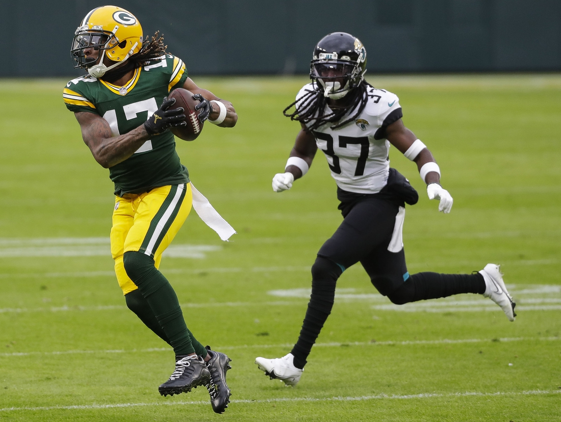 Nov 15, 2020; Green Bay, Wisconsin, USA;  Green Bay Packers wide receiver Davante Adams (17) catches a pass against the Jacksonville Jaguars during the first quarter  at Lambeau Field. Mandatory Credit: Tork Mason/USA TODAY NETWORK-Wisconsin via USA TODAY NETWORK
