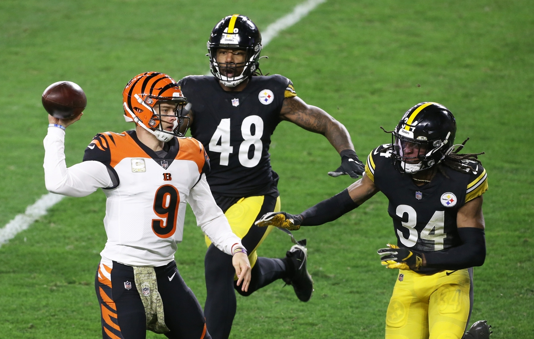 Nov 15, 2020; Pittsburgh, Pennsylvania, USA;  Cincinnati Bengals quarterback Joe Burrow (9) passes under pressure from Pittsburgh Steelers outside linebacker Bud Dupree (48) and strong safety Terrell Edmunds (34) during the second quarter at Heinz Field. Mandatory Credit: Charles LeClaire-USA TODAY Sports