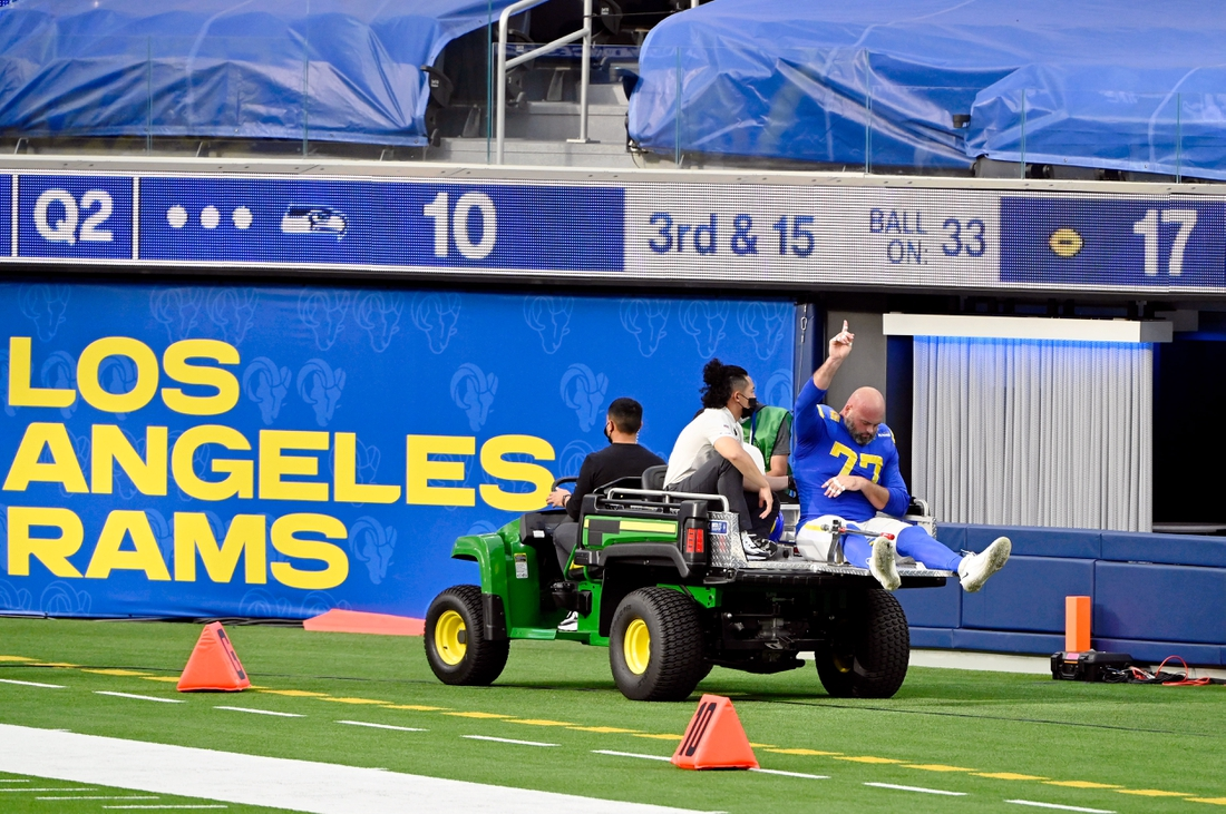 Nov 15, 2020; Inglewood, California, USA; Los Angeles Rams offensive tackle Andrew Whitworth (77) holds up a finger as he is carted off the field during the first half at SoFi Stadium. Mandatory Credit: Robert Hanashiro-USA TODAY Sports