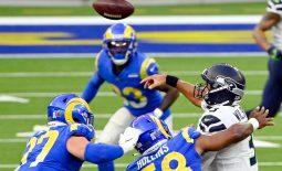 Nov 15, 2020; Inglewood, California, USA; Seattle Seahawks quarterback Russell Wilson (3) throws the ball while under pressure by Los Angeles Rams linebacker Justin Hollins (58) during the first half at SoFi Stadium. Mandatory Credit: Robert Hanashiro-USA TODAY Sports