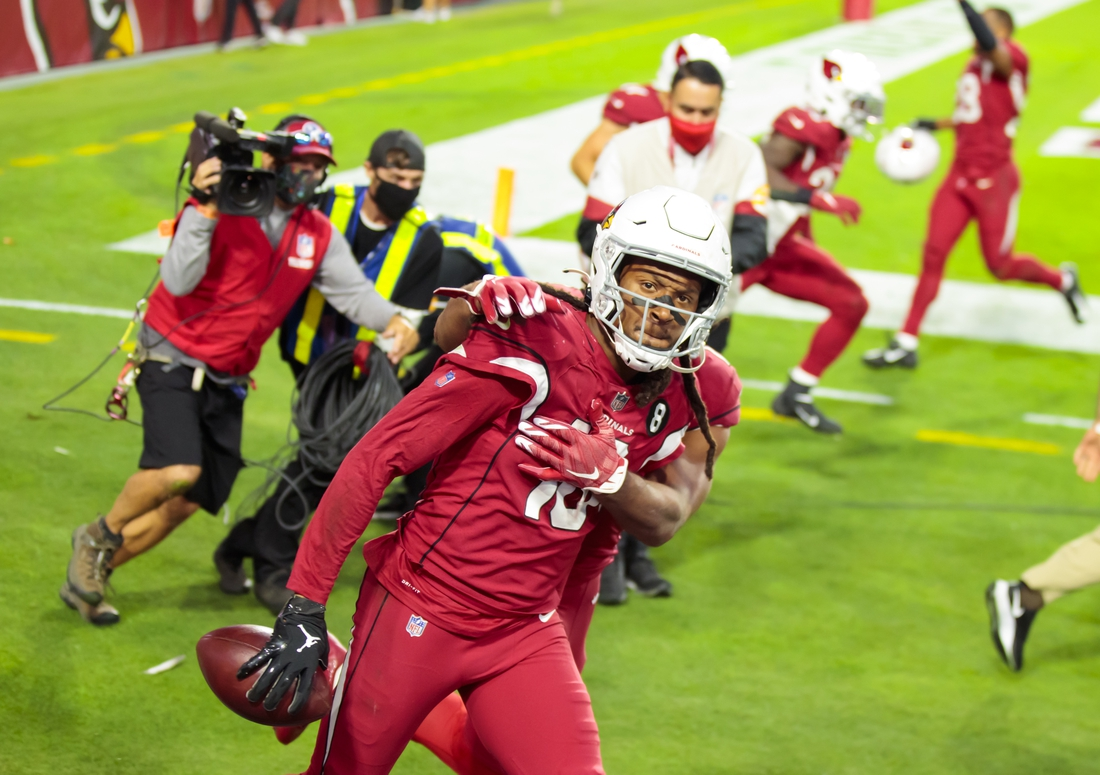 Nov 15, 2020; Glendale, Arizona, USA; Arizona Cardinals wide receiver DeAndre Hopkins (10) celebrates with teammates after catching a Hail Mary pass for a touchdown in the closing seconds of the game against the Buffalo Bills at State Farm Stadium. Mandatory Credit: Mark J. Rebilas-USA TODAY Sports