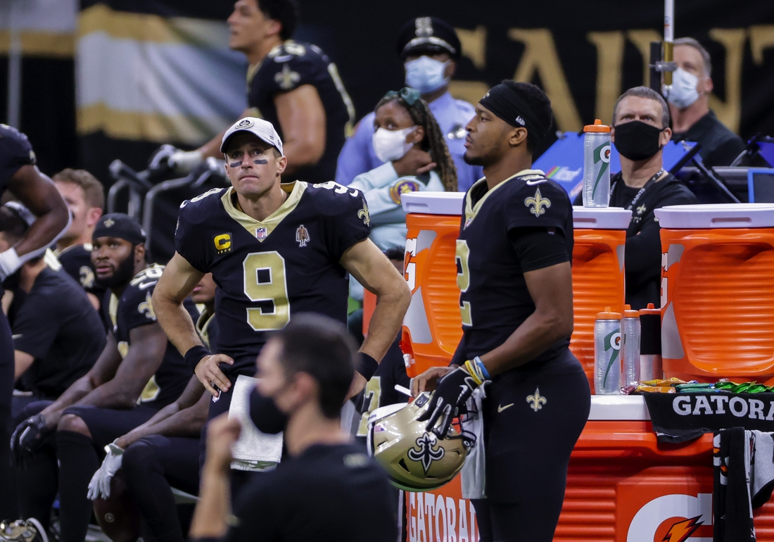 Nov 15, 2020; New Orleans, Louisiana, USA; New Orleans Saints quarterback Drew Brees (9) and quarterback Jameis Winston (2) on the sideline during the second half against the San Francisco 49ers at the Mercedes-Benz Superdome. Mandatory Credit: Derick E. Hingle-USA TODAY Sports