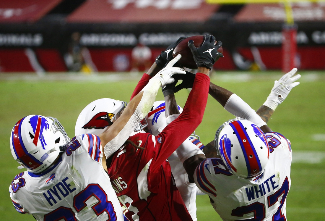 Nov 15, 2020; Glendale, Arizona, USA; Arizona Cardinals wide receiver DeAndre Hopkins (center) catches a Hail Mary pass for a touchdown in the closing seconds of the game against the Buffalo Bills at State Farm Stadium. Mandatory Credit: Patrick Breen-USA TODAY NETWORK