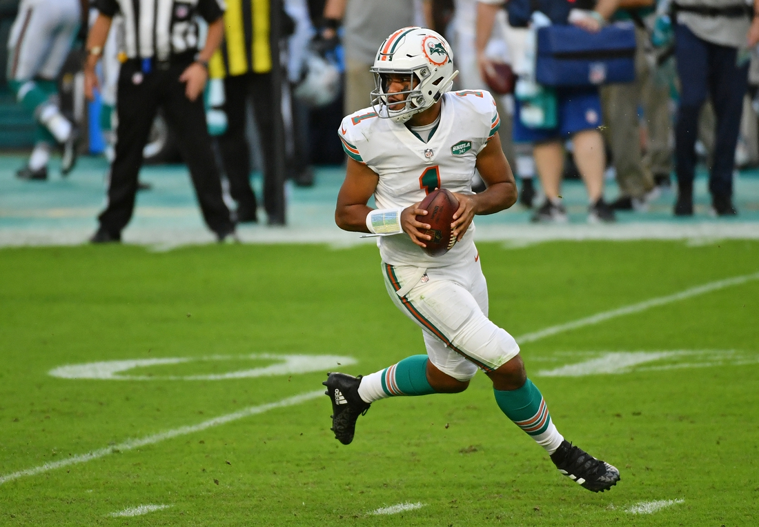 Nov 15, 2020; Miami Gardens, Florida, USA; Miami Dolphins quarterback Tua Tagovailoa (1) drops back with the ball against the Los Angeles Chargers during the first half at Hard Rock Stadium. Mandatory Credit: Jasen Vinlove-USA TODAY Sports