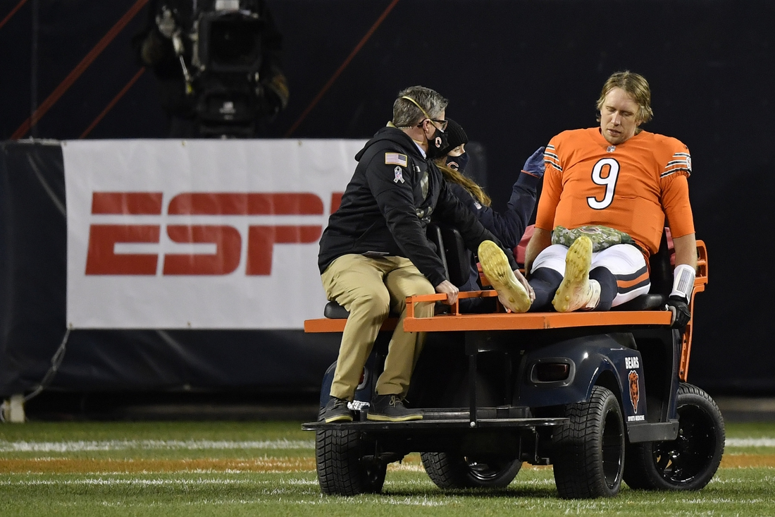 Nov 16, 2020; Chicago, Illinois, USA; Chicago Bears quarterback Nick Foles (9) leaves the game in the second half after an apparent injury against the Minnesota Vikings at Soldier Field. Mandatory Credit: Quinn Harris-USA TODAY Sports