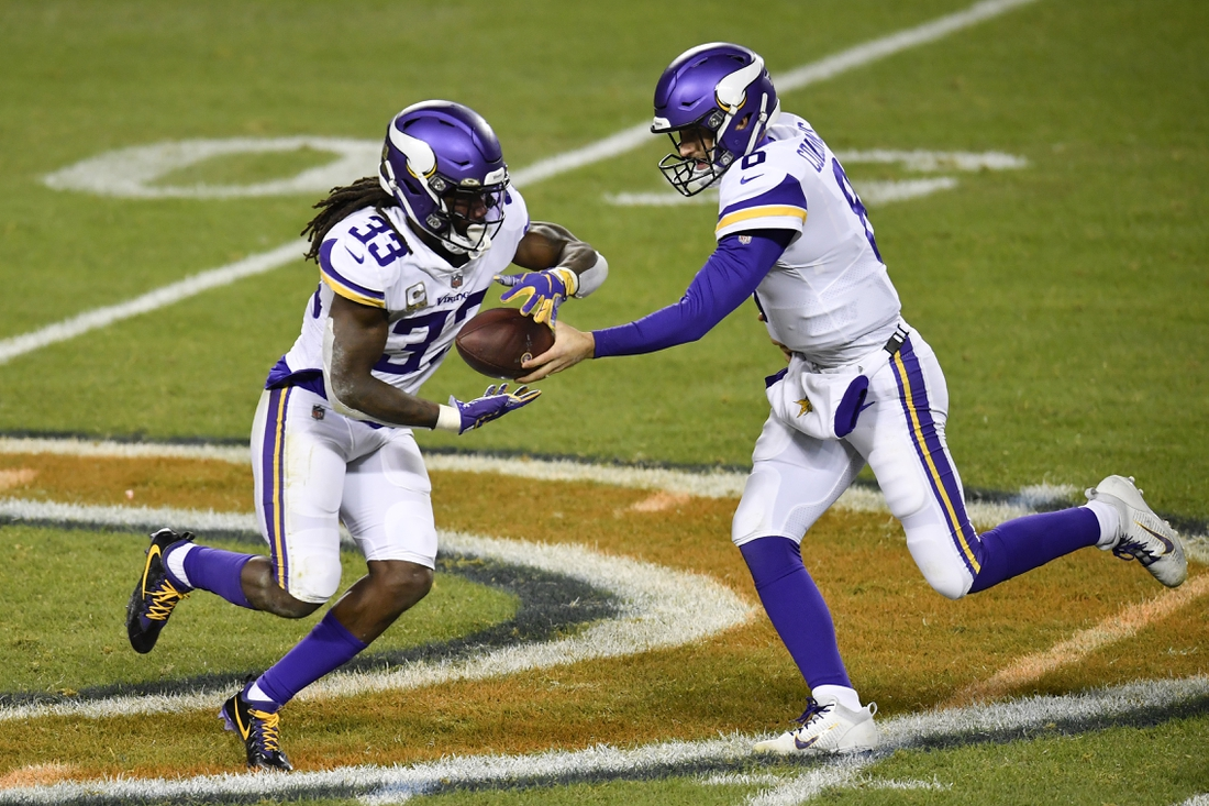 Nov 16, 2020; Chicago, Illinois, USA; Minnesota Vikings quarterback Kirk Cousins (8) hands the football to Minnesota Vikings running back Dalvin Cook (33) against the Chicago Bears at Soldier Field. Mandatory Credit: Quinn Harris-USA TODAY Sports
