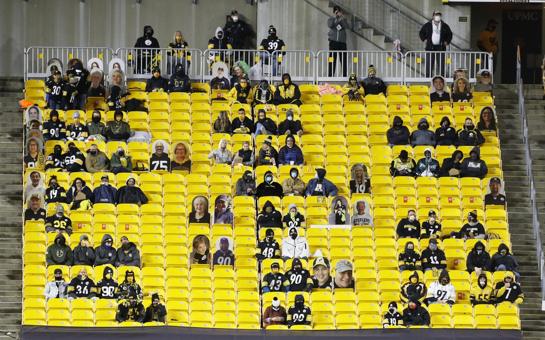 Nov 15, 2020; Pittsburgh, Pennsylvania, USA;  Real and cardboard cutout fans of the Pittsburgh Steelers watch the game against the Cincinnati Bengals during the third quarter at Heinz Field. The Steelers won 36-10. Mandatory Credit: Charles LeClaire-USA TODAY Sports