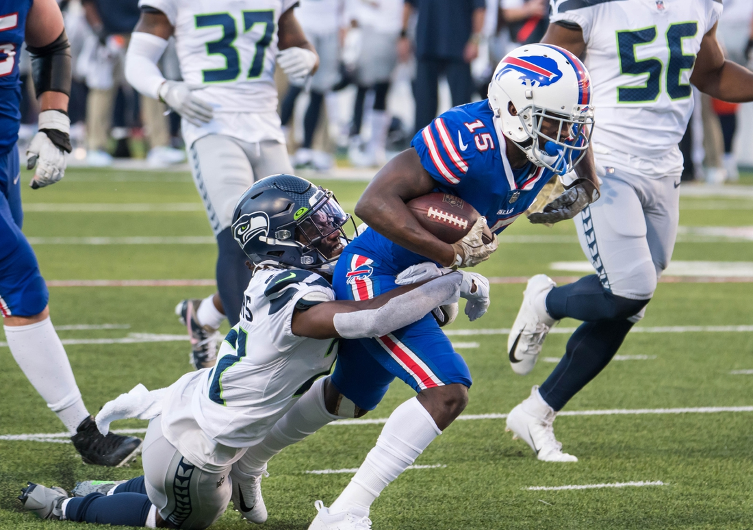 Nov 8, 2020; Orchard Park, New York, USA; Buffalo Bills wide receiver John Brown (15) is tackled by Seattle Seahawks cornerback Tre Flowers (21) after making a catch in the fourth quarter at Bills Stadium. Mandatory Credit: Mark Konezny-USA TODAY Sports