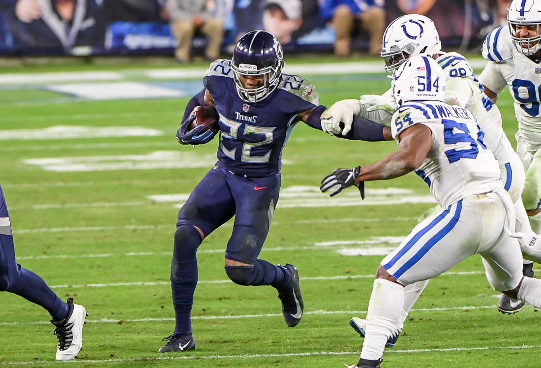 Nov 12, 2020; Nashville, Tennessee, USA;  Tennessee Titans running back Derrick Henry (22) runs the ball against the Indianapolis Colts during the second half at Nissan Stadium. Mandatory Credit: Steve Roberts-USA TODAY Sports